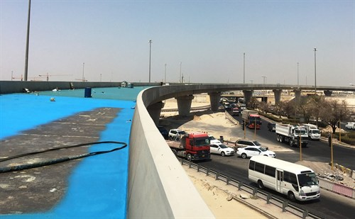 Worldwide, waterproofing contractors, working on a bridge